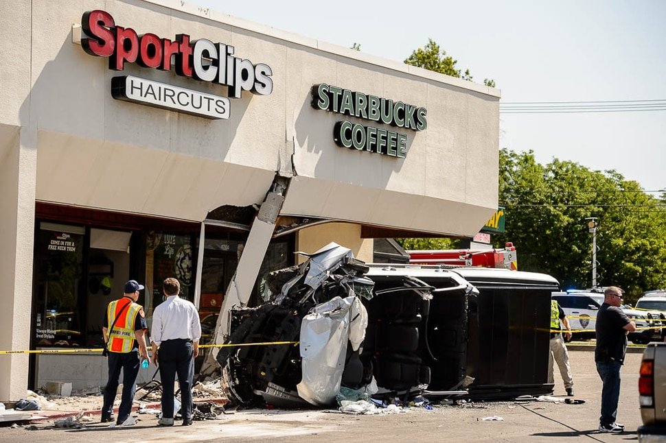 (Trent Nelson | The Salt Lake Tribune) One person was killed, and several injured, when a car drove into a Starbucks parking lot and into a patio Friday June 8, 2018 in Holladay.