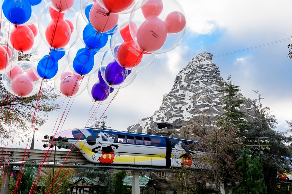 (Photo courtesy Richard Harbaugh/Disneyland Resort) The blue monorail at Disneyland dons a new celebratory and colorful design in honor of Get Your Ears On - A Mickey and Minnie Celebration.