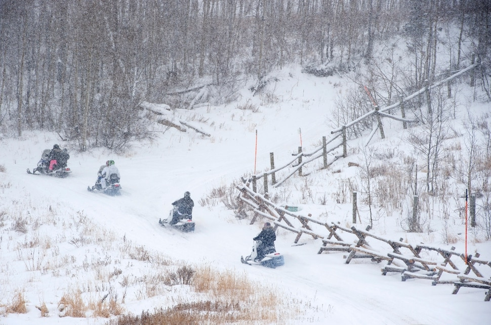 (Scott Sommerdorf   The Salt Lake Tribune) The Varvell family visiting from Connecticut rented snowmobiles at Daniel Summit Saturday, December 23, 2017. While the number of snowmobile licenses in Utah is declining, trail usage is up dramatically.