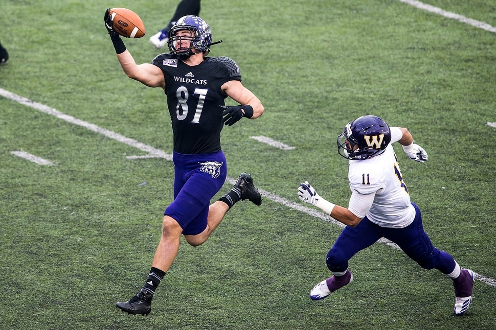 (Chris Detrick | The Salt Lake Tribune) Weber State Wildcats tight end Andrew Vollert (87) makes a one-handed catch past Western Illinois Leathernecks defensive back Eric Carrera (11) during the game at Stewart Stadium Saturday, November 25, 2017.