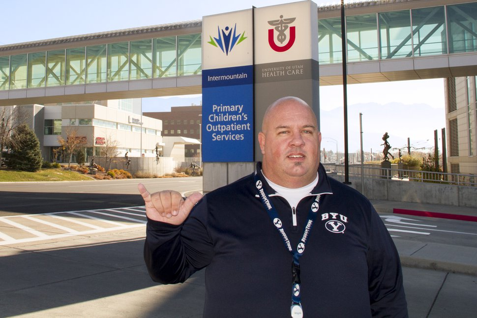 Photo courtesy Brian Endicott: BYU fan Brian Endicott shown here outside Primary Children's Hospital, where he's one of a very few BYU fans who work at the hospital in Salt Lake City.