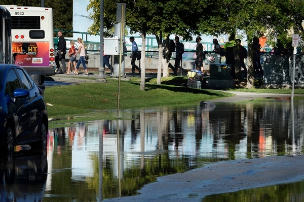 Scott Sommerdorf | The Salt Lake Tribune Northbound TRAX riders were taken via a bus bridge from the Ballpark Station to the next stop. Northbound Main Line TRAX trains were prevented from leaving the station due to flooding, Wednesday, July 26, 2017.