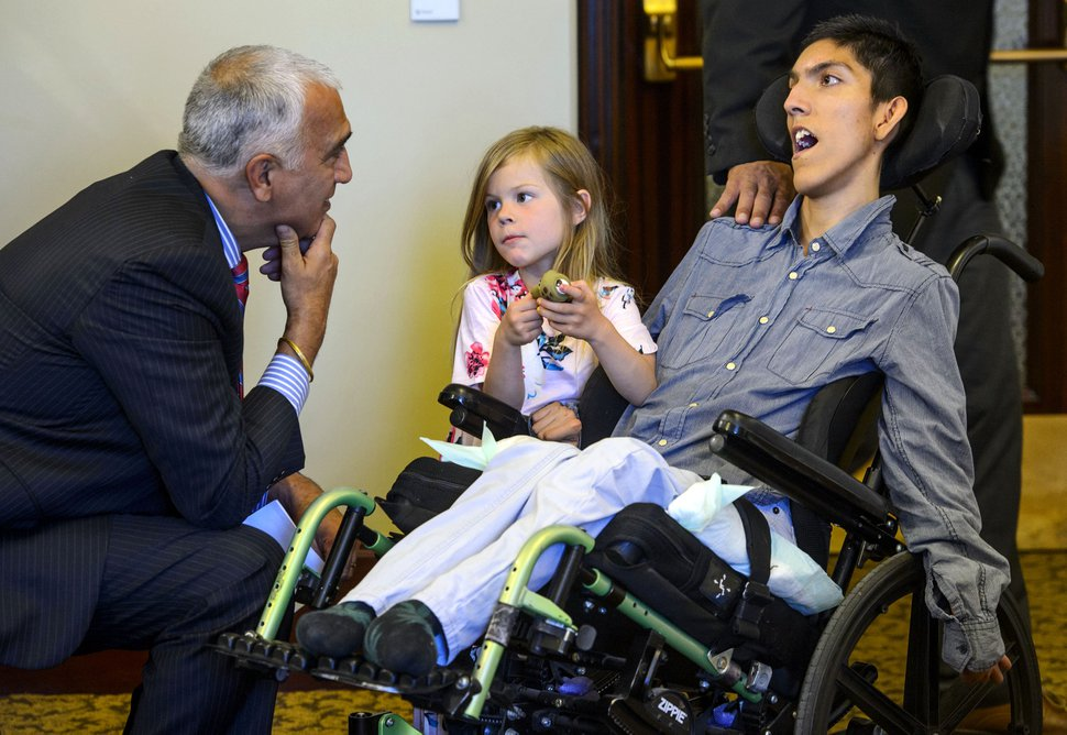 (Steve Griffin | Tribune file photo) Salt Lake County District Attorney Sim Gill talks with Willow Hennessy and her adopted brother Hestevan before a news conference held by TRUCE, a group of concerned patients and caregivers advocating for safe legal access to medical cannabis in Utah, at the state Capitol on Tuesday, May 8, 2018. Hestevan suffers from seizures that are controlled by medicines, but he also suffers from chronic pain that medicine doesn't help.