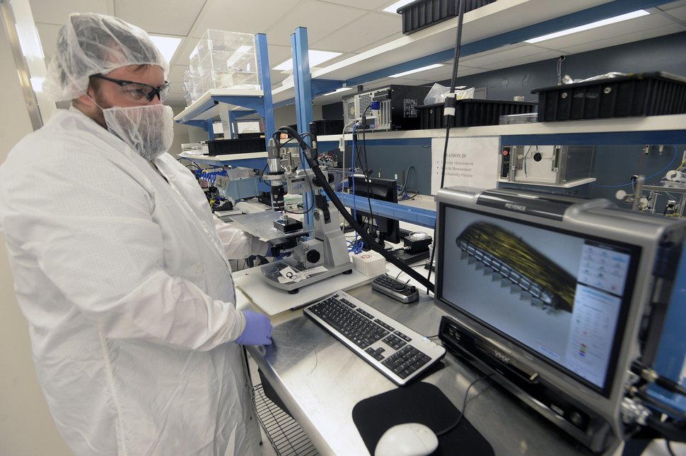 (Al Hartmann | The Salt Lake Tribune) Technician Chrisman Cook finishes assembling array in the clean room at Blackrock. The company has developed a computer chip that is implanted in the brain of amputees or paraplegics. The chip allows them to move robotic devices like prosthetic limbs.