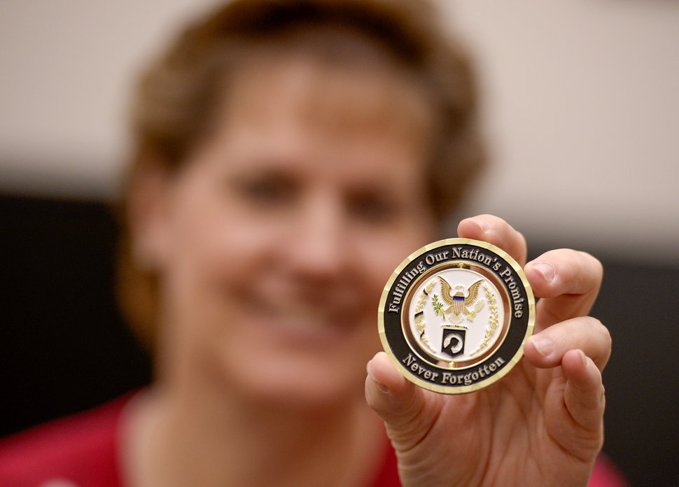 Leah Hogsten | The Salt Lake Tribune Brigham Young University professor Jill Crandell, director of BYUÕs Center for Family History and Genealogy proudly holds a challenge coin from the Army and the Defense POW/MIA Accounting Agency (DPAA) that was given on behalf of the university's work of bringing closure for families and loved ones of more than 82,000 Americans still missing from conflicts as far back as WWII. The Center for Family History and Genealogy researchers and students start with a soldier's DNA and then search for the closest living relative in the hopes of returning the soldier's remains to their family members.