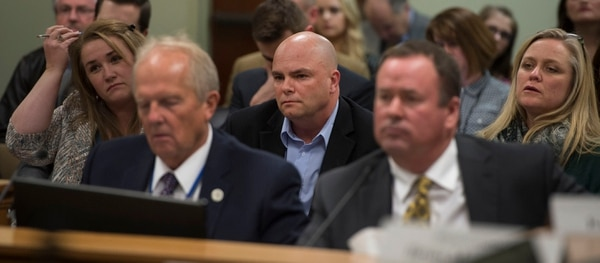 Steve Griffin / The Salt Lake Tribune Polygamist Joe Darger, center, listens as Rep. Mike Noel, R-Kanab, left, present HB99 to members of the House Judiciary Standing Committee in the House Building Room 20 on Capitol Hill in Salt Lake City Wednesday February 1, 2017. HB99 clarifies polygamy is a felony in Utah.