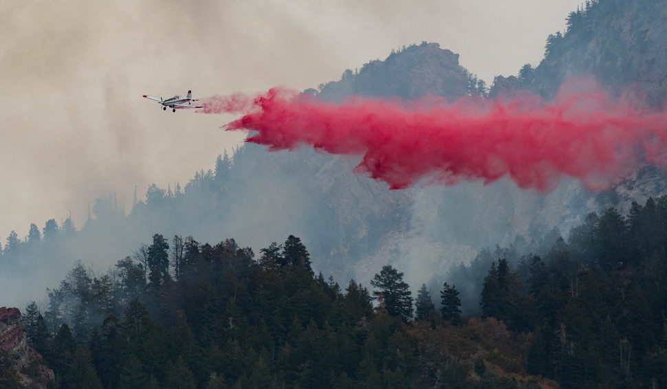 (Francisco Kjolseth | The Salt Lake Tribune) Air crews battle a fire in Neffs Canyon on the north side of Mount Olympus on Tuesday, Sept, 22, 2020.