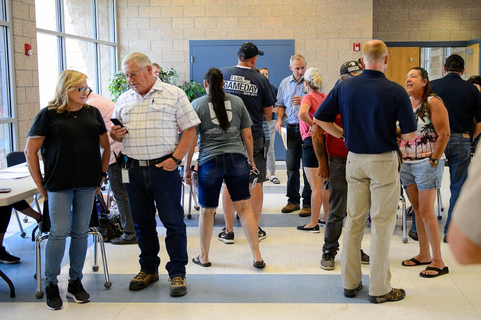 (Trent Nelson | The Salt Lake Tribune) Officials, volunteers, and evacuees of the Dollar Ridge Fire at Duchesne High School in Duchesne, Tuesday July 3, 2018.