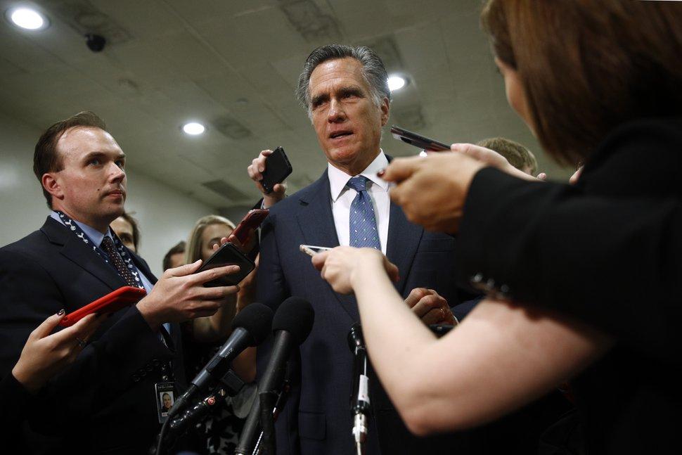 (Patrick Semansky | AP file photo) Sen. Mitt Romney, R-Utah, speaks to reporters last May after a classified members-only briefing on Iran.