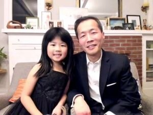 """(Photo courtesy of NBC) Lee Isaac Chung,  winner of best motion picture – foreign language for """"Minari"""" and his daughter on the Golden Globes telecast in February."""
