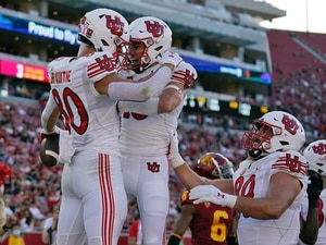 Utah tight end Brant Kuithe (80) celebrates his touchdown with wide receiver Britain Covey during the first half of an NCAA college football game against Southern California, Saturday, Oct. 9, 2021, in Los Angeles. (AP Photo/Marcio Jose Sanchez)