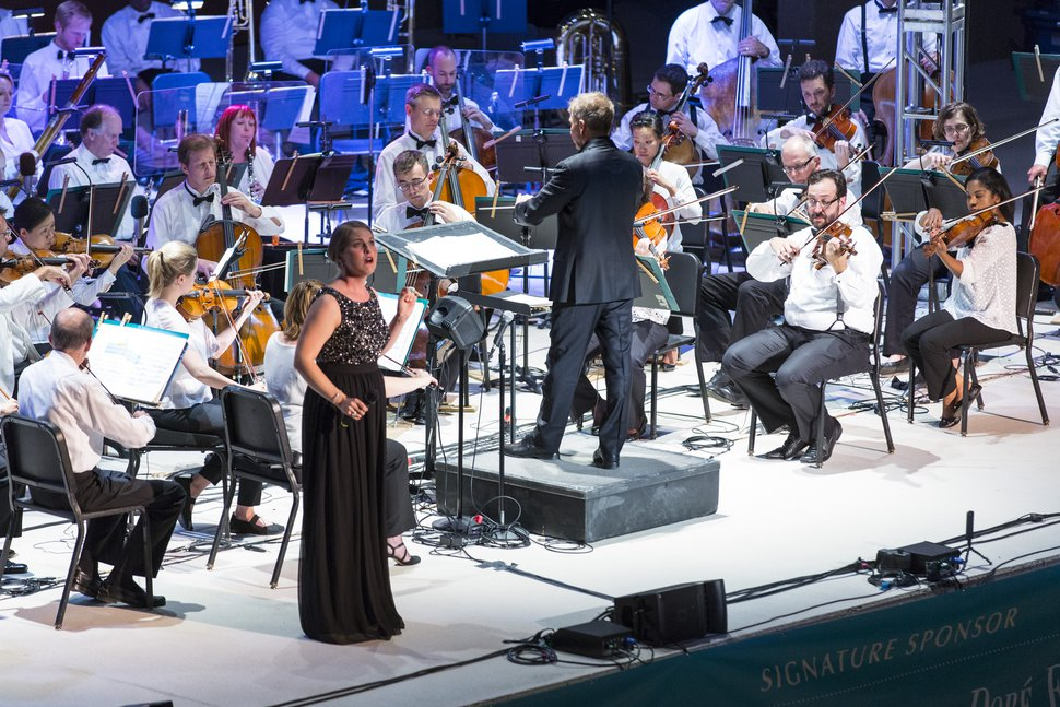 (Courtesy Marc Estabrook/Utah Symphony) Soprano Abigail Rethwisch sings with the Utah Symphony, led by music director Thierry Fischer, as the orchestra kicks off its Great American Road Trip on Tuesday, Aug. 29, at O.C. Tanner Amphitheater in Springdale. The tour will cover 1,200 miles over five days in Utah, ending Saturday, Sept. 2, at Dinosaur National Monument.
