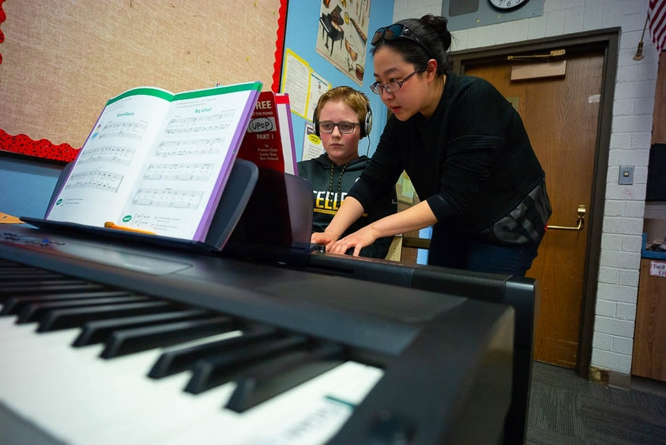 (Trent Nelson | The Salt Lake Tribune) Yuhuan Xu helps student Tyce Randall in the piano lab at Salt Lake City's Bennion Elementary, which might be closing due to low enrollment. The school district is holding a meeting Tuesday Feb. 19, 2019 to discuss the issue and hear from parents.