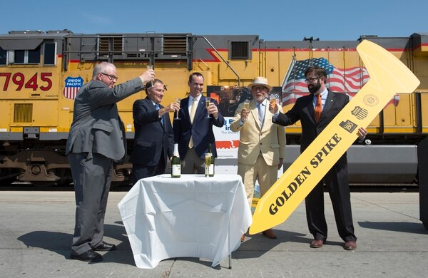 (Rick Egan   The Salt Lake Tribune) Left to right Historian Brad Westwood, Gov. Gary Herbert, Clint Schelbitski Union Pacific Vice-President, Public Affairs, Doug Foxley, Spike 150 Celebration co-chair, and Nathan Anderson, Union Pacific director of public relations have a toast as they announce the 150 anniversary celebration of the Golden Spike, at the Union Pacific Intermodal Facility, Thursday, Aug. 16, 2018.