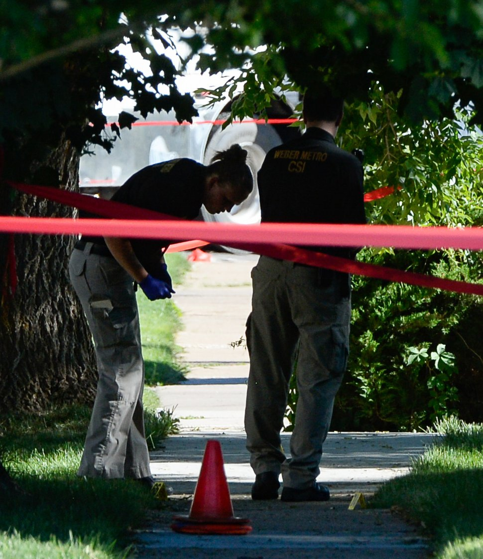 (Francisco Kjolseth | The Salt Lake Tribune) A CSI team looks for evidence as Ogden Police Department crime scene investigators work the scene on Jackson Avenue on Thursday. An Ogden police officer died in a shooting after responding to a domestic violence call May 28, 2020 in the area of Jackson Avenue and Harrop Street shortly after noon. A suspect was killed and an officer with Adult Probation and Parole was injured at the scene.
