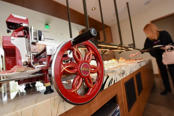 (Francisco Kjolseth   The Salt Lake Tribune) Hannah Mohler, breakfast host at the new AC Hotel in Salt Lake City, uses the $10,000 Berkel prosciutto slicer to cut paper-thin slices of cured meat.