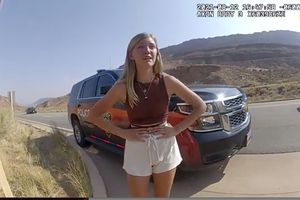 """(Moab Police Department) Gabrielle """"Gabby"""" Petito talks to a police officer after police pulled over the van she was traveling in with her boyfriend, Brian Laundrie, near the entrance to Arches National Park on Aug. 12, 2021. The couple was pulled over while they were arguing. Petito was reported missing by her family a month later and is now the subject of a nationwide search."""