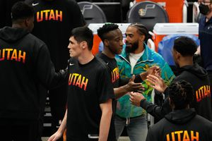 (Francisco Kjolseth   The Salt Lake Tribune) Utah Jazz guard Mike Conley (10) engages in one of many special handshakes with teammates before the start of the game against the Portland Trail Blazers, at Vivint Smart Home Arena, on Wednesday, May 12, 2021. Conley missed his fourth straight game in the Jazz-Clippers series after tweaking his hamstring in Game 5 of the Memphis series.
