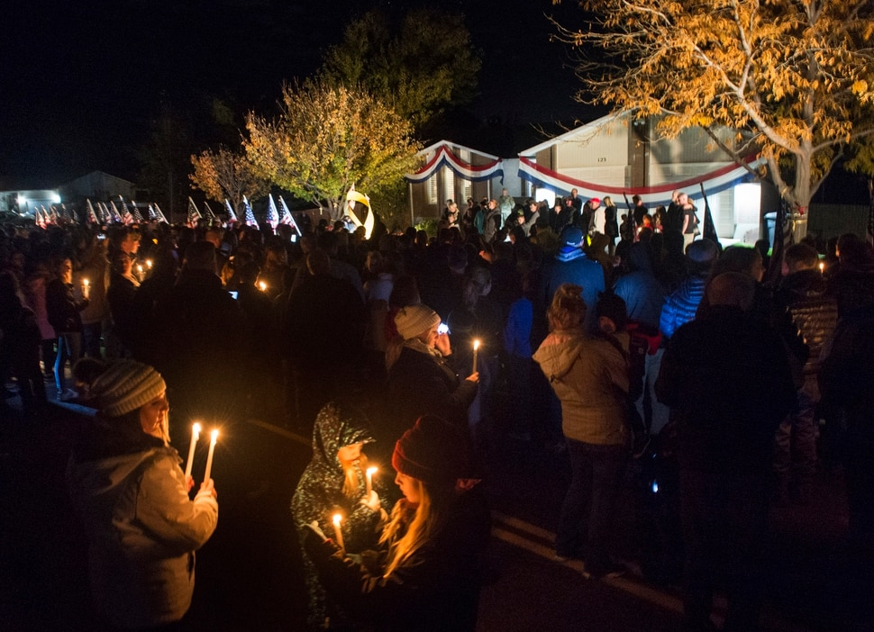 (Rick Egan | The Salt Lake Tribune) Friends and neighbors gather for a candlelight vigil in front of the home of Brent Taylor, in North Ogden. Taylor, the Mayor of North Ogden, and a major in the National Guard, was killed Saturday in an insider attack in Kabul, Afghanistan. Wednesday, Nov. 7, 2018. Wednesday, Nov. 7, 2018.