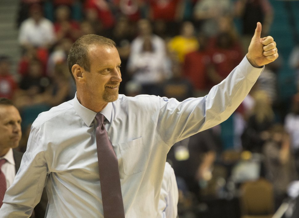 Rick Egan | The Salt Lake Tribune Utah Utes head coach Larry Krystkowiak salutes the Utah fans as he leaves the court after Utah's 80-72, in PAC-12 Basketball Championship action, at the MGM Arena, in Las Vegas, Thursday, March 10, 2016.