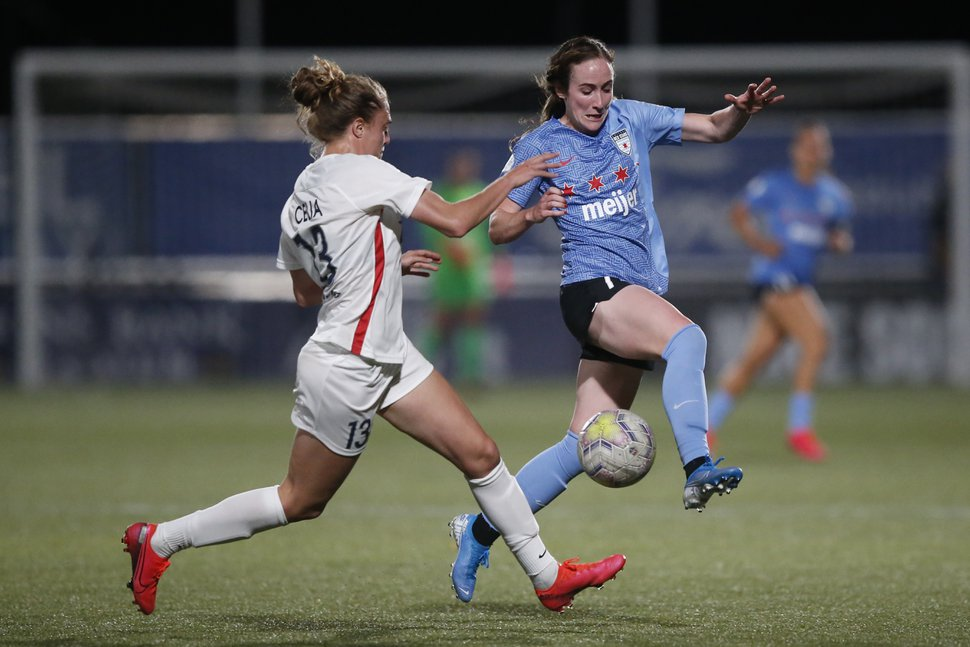 Chicago Red Stars' Michele Vasconcelos (7) and OL Reign's Celia Jiménez Delgado (13) battle for the ball during the second half of an NWSL Challenge Cup soccer match at Zions Bank Stadium Saturday, July 18, 2020, in Herriman, Utah. (AP Photo/Rick Bowmer)