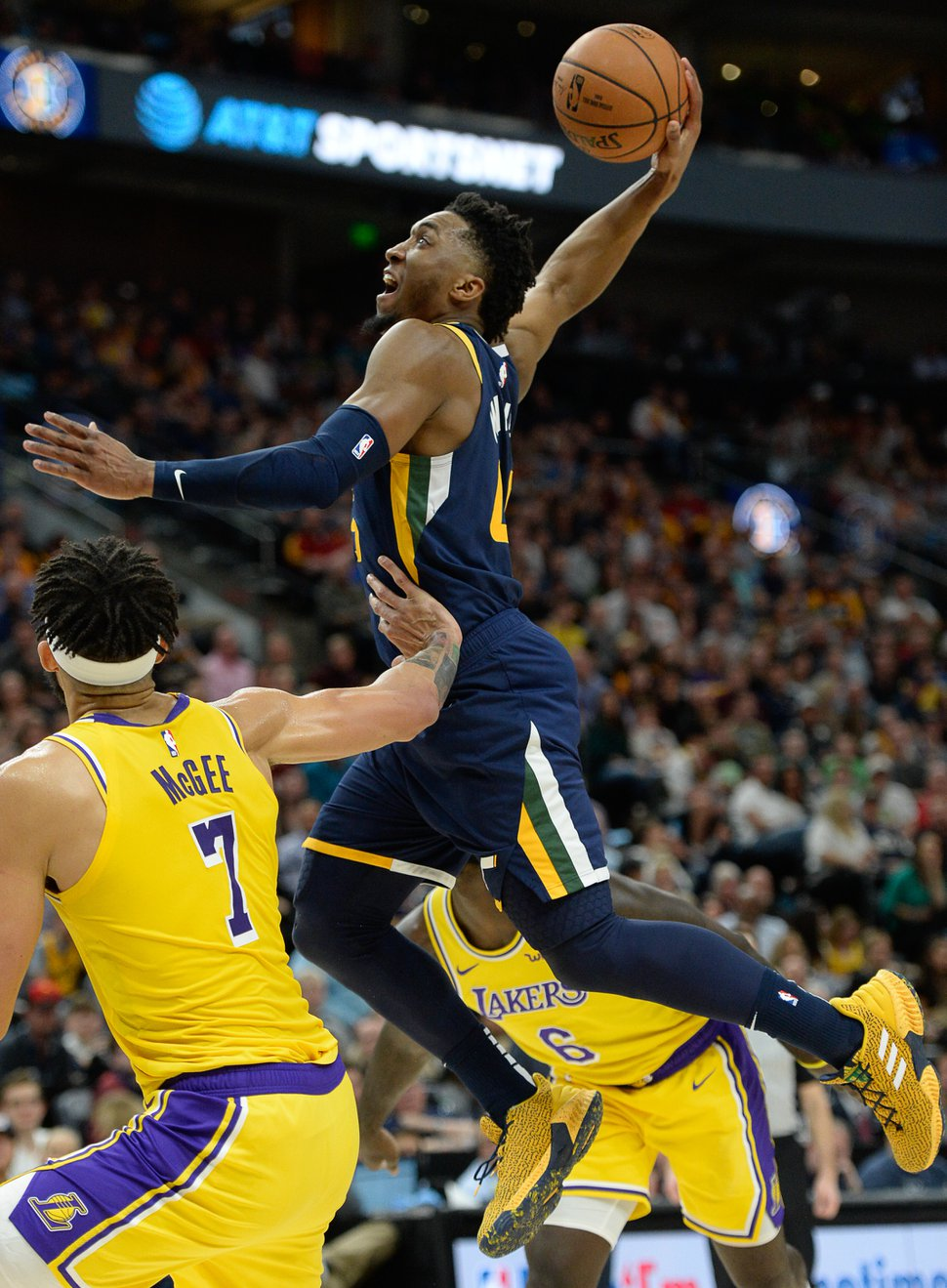 (Francisco Kjolseth | The Salt Lake Tribune) Utah Jazz guard Donovan Mitchell (45) sails in for a dunk in the final seconds of the first half as the Utah Jazz face the Los Angeles Lakers in their NBA game at Vivint Smart Home Arena Wed., March 27, 2019, in Salt Lake City.