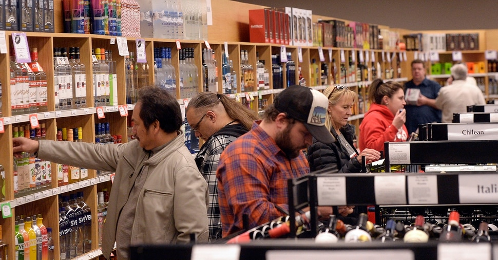 (Al Hartmann | The Salt Lake Tribune) Shoppers fill the ailes at the Cottonwood Heights state liquor store Wednesday Nov. 22. The Wednesday before Thanksgiving is typically one of the busiest days for liquor sales in Utah. Customers typically line up outside before the 11 a.m. opening. Extra employees work to handle the holiday rush.