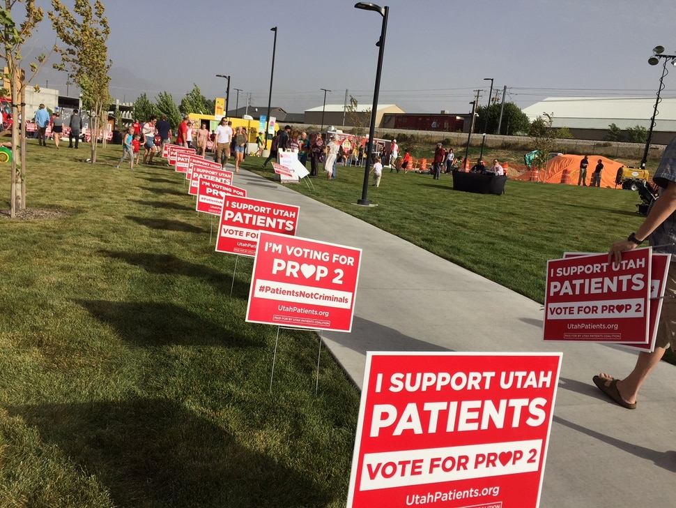 (The Salt Lake Tribune | Kathy Stephenson) Supporters of Proposition 2 picked up T-shirts and lawn signs during a kick-off rally in Midvale.