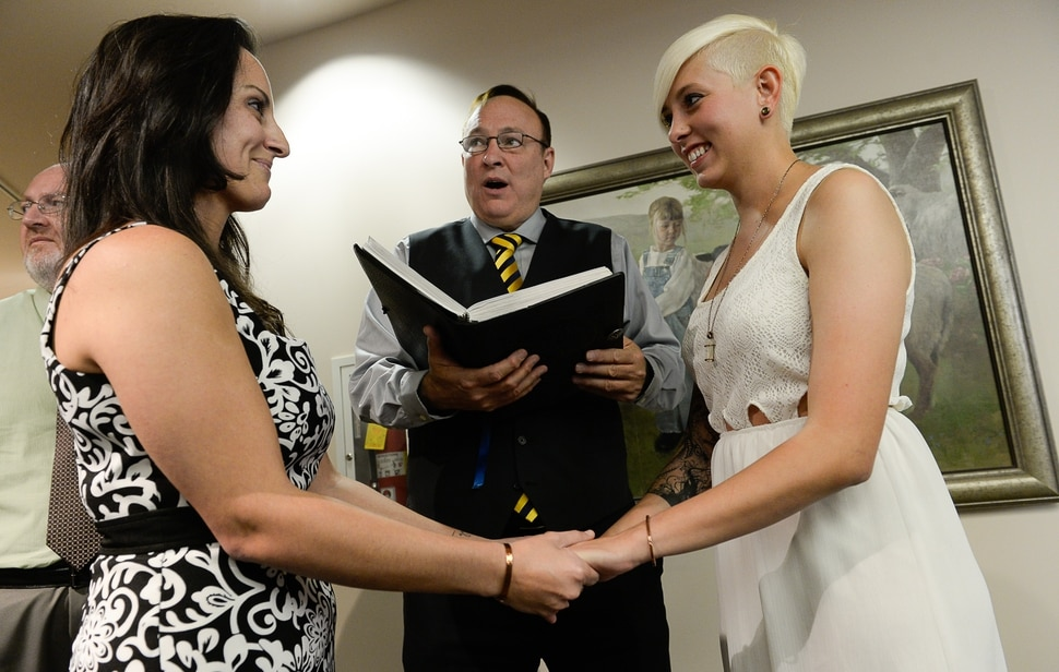 Francisco Kjolseth | The Salt Lake Tribune Senator Jim Dabakis marries Yolanda Pascua, left, and Laekin Rogers on Monday at the Salt Lake County Complex. The U.S. Supreme Court declined to review all five pending same-sex marriage cases on Monday, Oct. 6, 2014 effectively legalizing gay and lesbian unions, clearing the way for such marriages to proceed in eleven new states - including Utah.