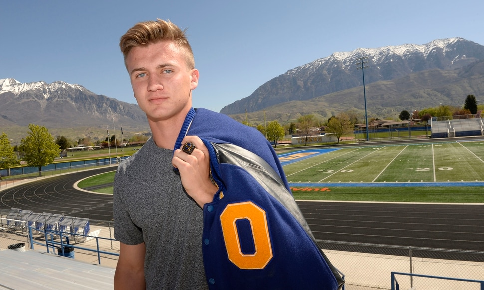 (Al Hartmann | The Salt Lake Tribune) Orem High School Junior Cooper Legas has won a state title in three consecutive seasons. He won a title in the javelin at last year's state track meet, was the quarterback on the state-title winning football team then won a state title as a wrestler.