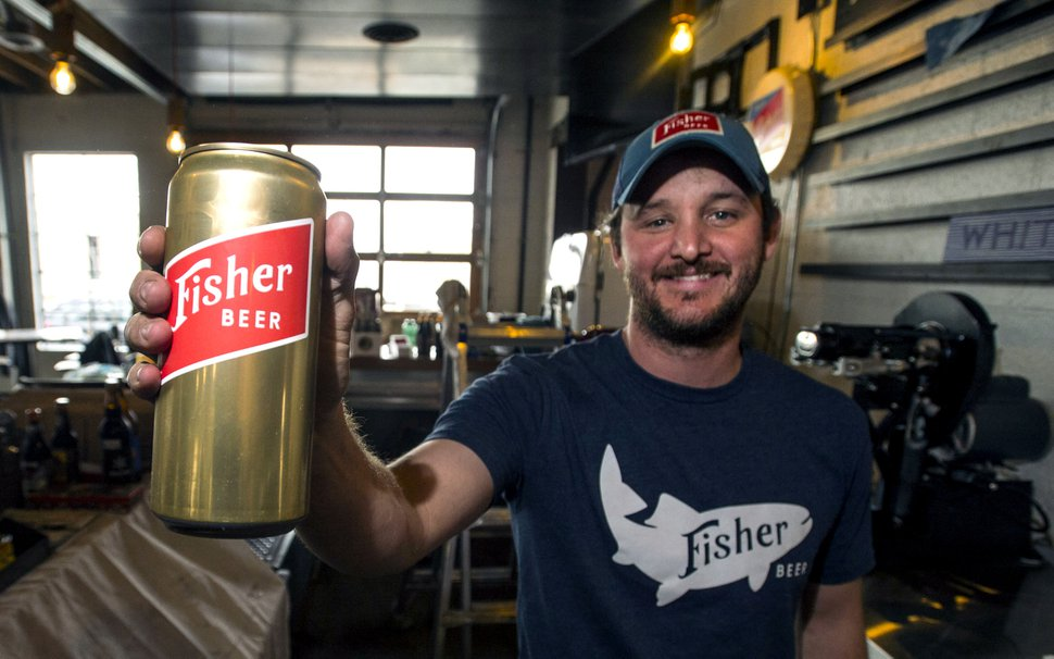 (Steve Griffin | Tribune file photo) Steven Brown holds a fresh can of bear at the new A. Fisher Brewing Company in Salt Lake City.