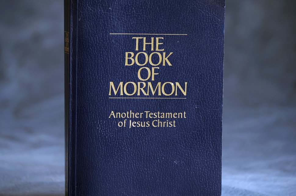 (AP Photo/Rick Bowmer) The Book of Mormon is shown Tuesday, Aug. 21, 2018, Salt Lake City. Sheraton, Westin and other Starwood hotels are finding their religion. Marriott International, which bought Starwood two years ago, has begun putting copies of the Bible and the Book of Mormon in Sheratons, Westins and other hotels in the Starwood family.