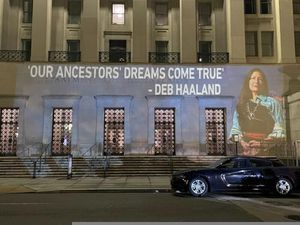 (Leah Salgado via AP) This photo provided by Leah Salgado shows the image of New Mexico U.S. Rep. Deb Haaland projected on the side of the U.S. Department of the Interior building in Washington, D.C., on Monday, Feb. 22, 2021. Native Americans will be closely watching a confirmation hearing Tuesday, Feb. 23, 2021, for Haaland, who has been nominated to lead the Interior Department. If confirmed, she would be the first Native American to lead the agency that has broad oversight of tribal affairs and energy development.
