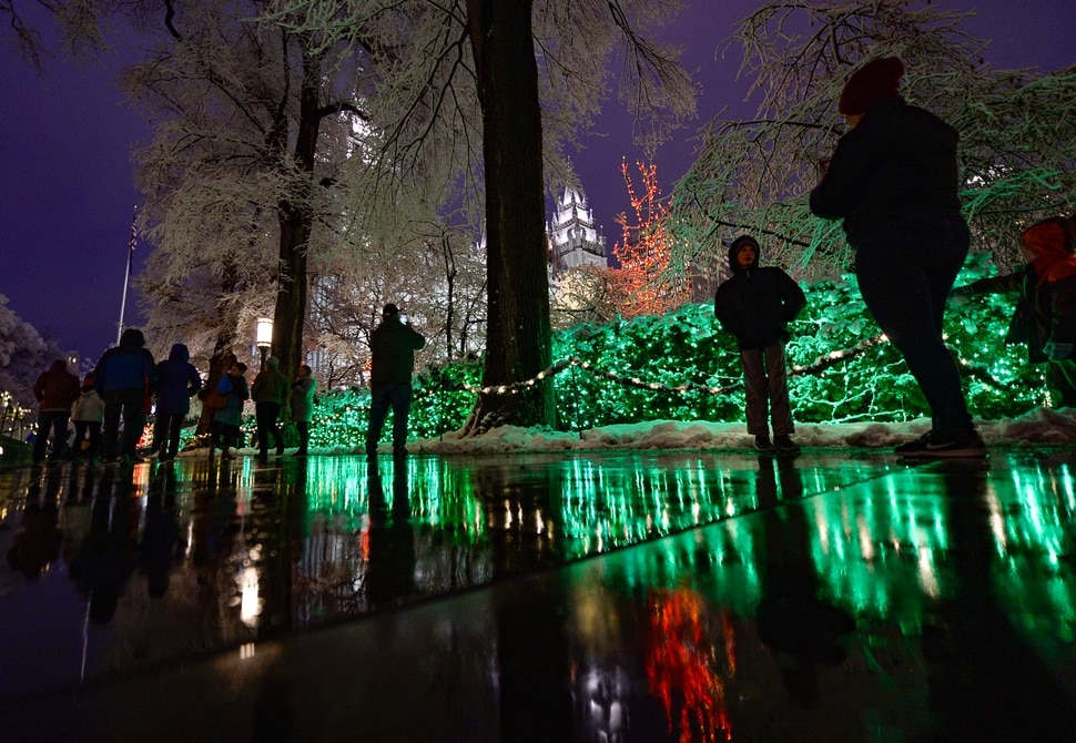 (Francisco Kjolseth | The Salt Lake Tribune) Visitors take in the sights as Temple Square in Salt Lake City comes to life Friday, November 29, 2019, as hundreds of thousands of colorful LED bulbs light up, a yearly tradition that started in 1965. The lights will run through the end of the year.