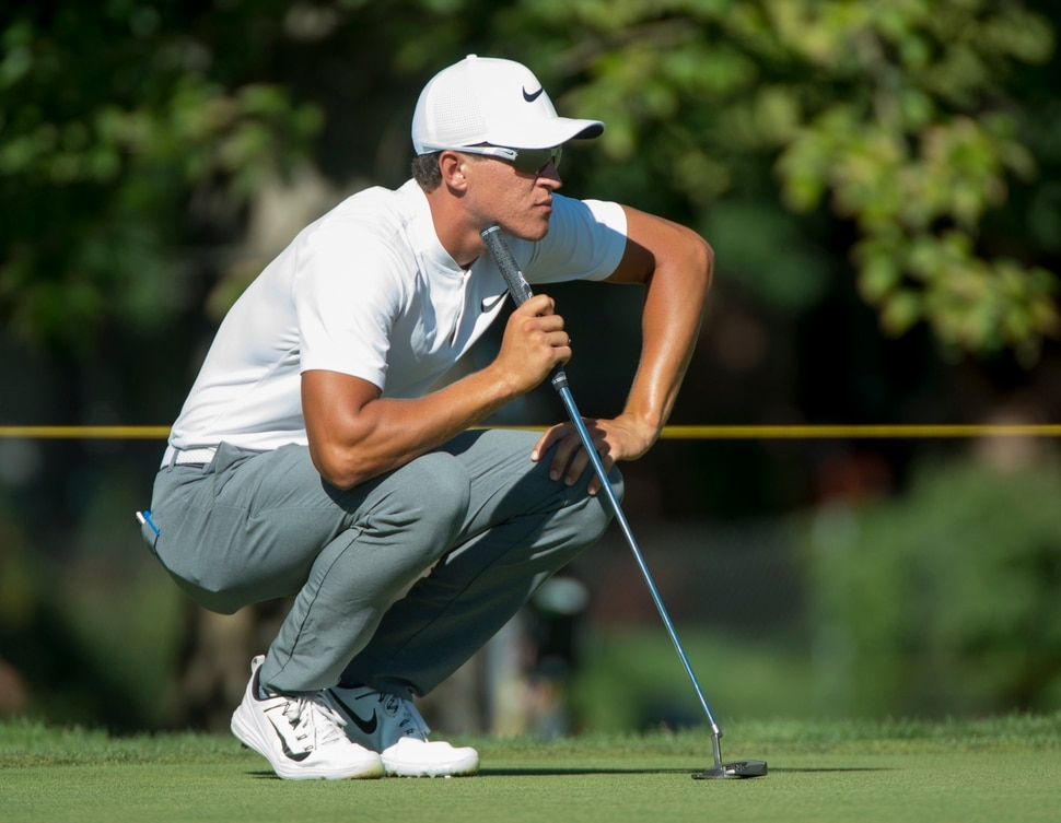 (Rick Egan | The Salt Lake Tribune) Cameron Champ from Sacramento, CA, looks over a putt on the first day of the Utah Championship golf event on the Web.com Tour. Champ finished in the lead today at 10 under par. Thursday, July 12, 2018.