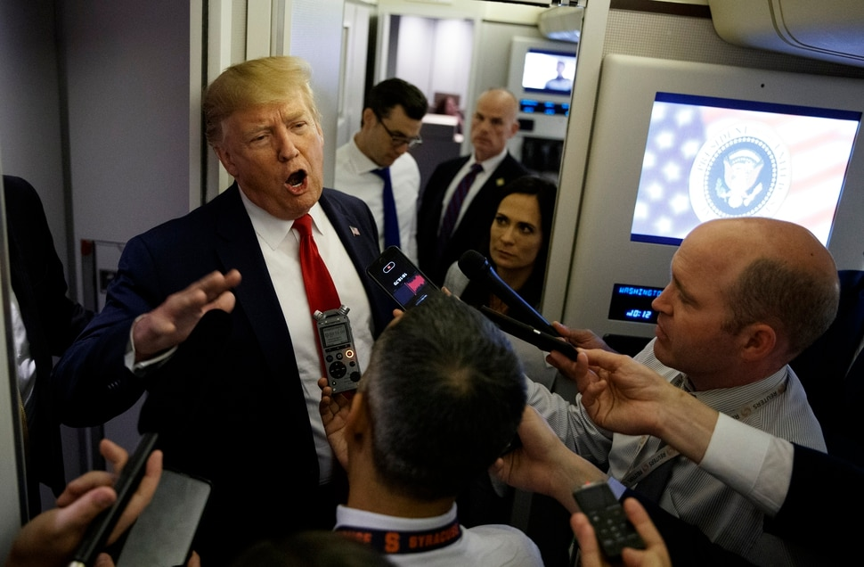 (Evan Vucci | AP Photo) President Donald Trump talks to reporters aboard Air Force One after visiting Dayton, Ohio and El Paso, Texas, Wednesday, Aug. 7, 2019.