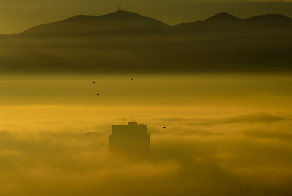 (Steve Griffin | Tribune file photo) The Church Office Building rises from dense fog as an inversion settles over the Salt Lake City on Tuesday, December 26, 2017.