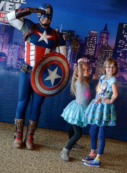 (Francisco Kjolseth | The Salt Lake Tribune) Captain America poses for a photo with Addy Cook, 9, center, and her sister Hailey, 10, as Utah-based military families gather for the Salt Lake opening night of the all-new Marvel Universe LIVE! Age of Heroes, witnessing their favorite Marvel super heroes, including The Avengers, Spider-Man and the Guardians of the Galaxy in an action-packed adventure at the Maverik Center on Thursday, Sept. 28, 2017. MarvelÕs greatest military Super Hero Captain America was partnered with Got Your 6, a military veteran non-profit group dedicated to empowering veterans to lead and build stronger communities across America.