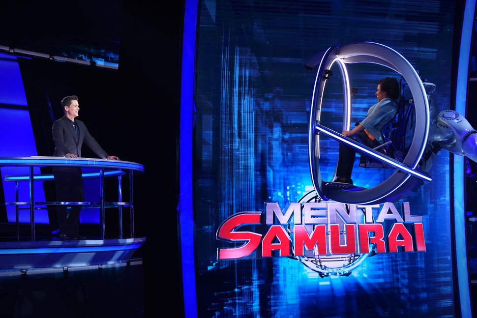 "(Photo courtesy of Ray Mickshaw | Fox) Rob Lowe and a contestant on ""Mental Samurai."""