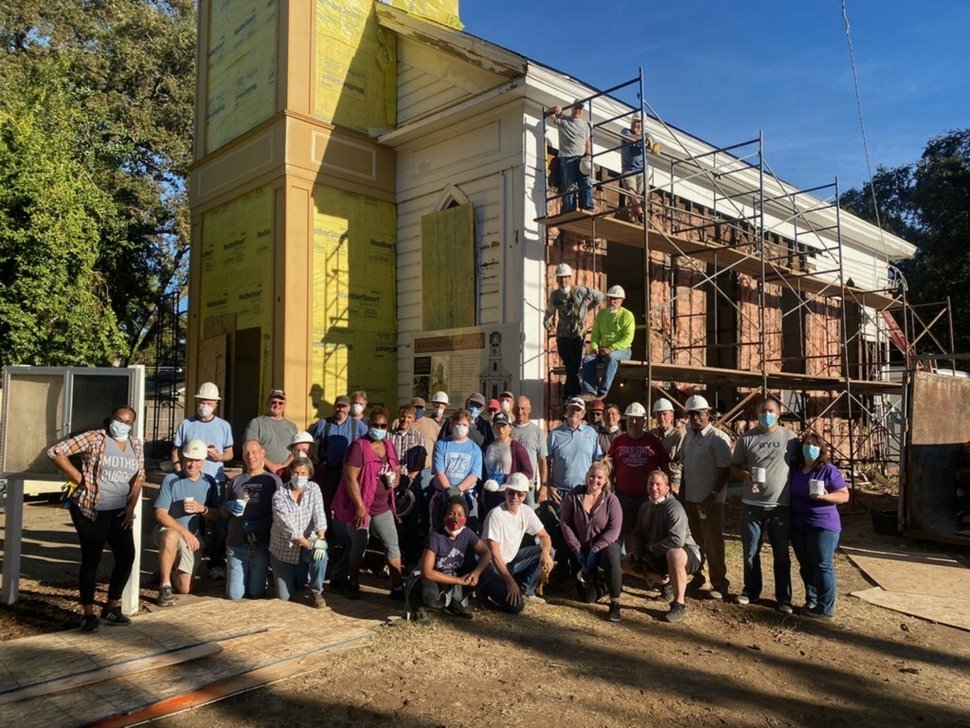 (Photo courtesy of The Church of Jesus Christ of Latter-day Saints) Members of the Chico, Calif., community and various churches join in an interfaith day of service to restore the bell tower and steeple on the Bethel AME Church.