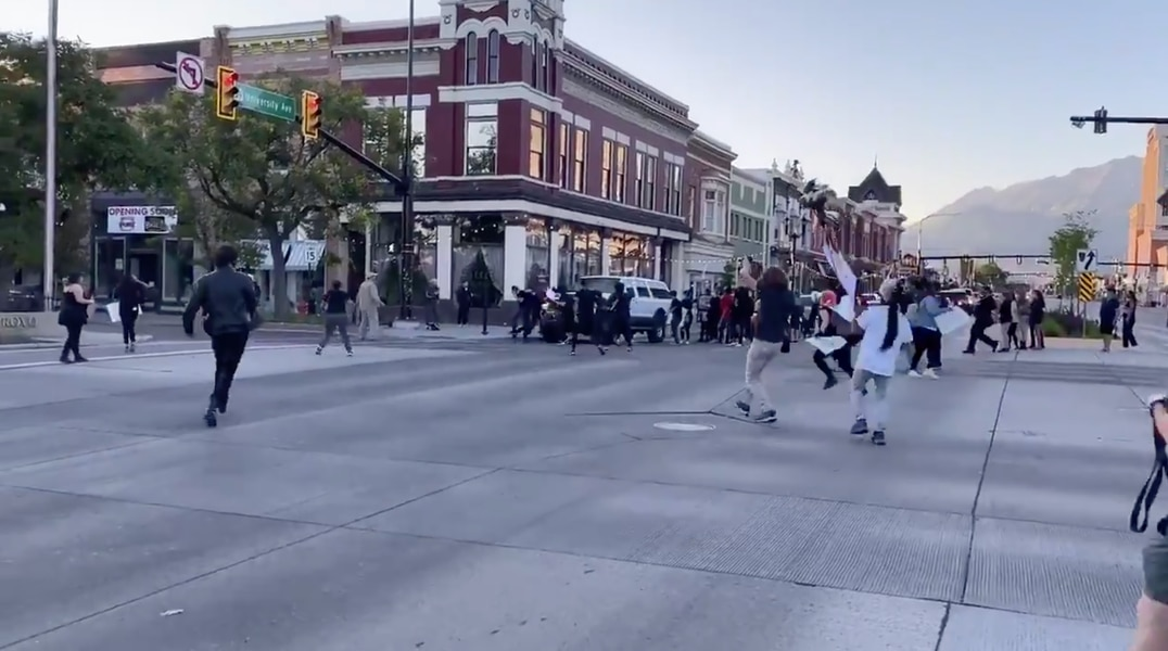 Police arrest two people after shooting of man who drove through crowd of protesters in Provo