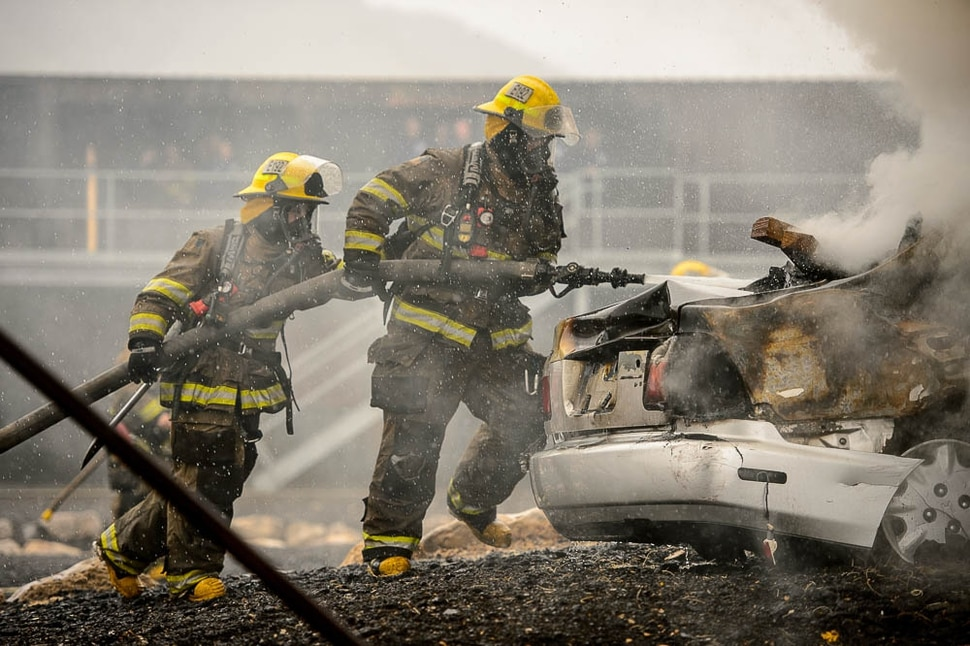 (Trent Nelson | The Salt Lake Tribune) Unified Fire recruits in a live response to a vehicle and structure fire at the Unified Fire Authority Training Center in Magna on Tuesday April 16, 2019.