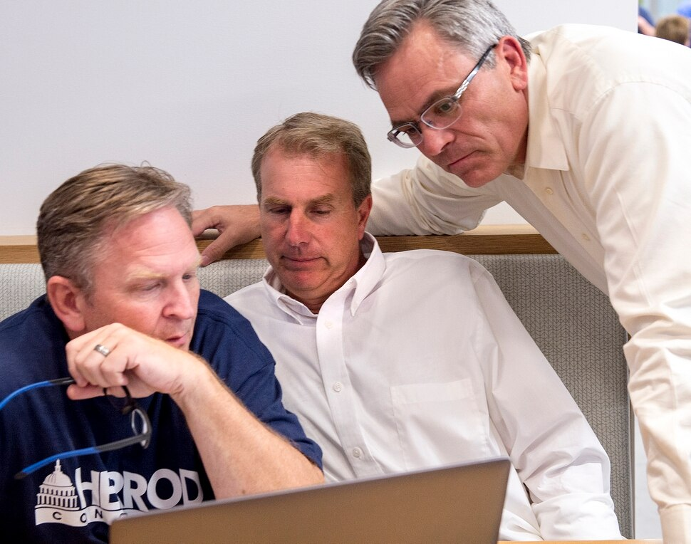 (Leah Hogsten | The Salt Lake Tribune) Former state Rep. Chris Herrod (center) sits between his campaign managers Craig Frank, left, and Ken Sumsion, right, as the three watch the polls Tuesday, August 15, 2017 on election night. Registered Republican voters in the 3rd Congressional District will decide whether Provo Mayor John Curtis, former state Rep. Chris Herrod or businessman Tanner Ainge moves forward to the general election. The winner takes on Democrat Kathie Allen and the United Utah PartyÕs Jim Bennett, as well as a handful of independent and third-party candidates, on Nov. 7.