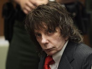 "(Jae C. Hong | AP file photo, pool) In this May 29, 2009, file photo, music producer Phil Spector sits in a courtroom for his sentencing in Los Angeles. Spector, the eccentric and revolutionary music producer who transformed rock music with his ""Wall of Sound"" method and who was later convicted of murder, died Saturday, Jan. 16, 2021, at age 81."