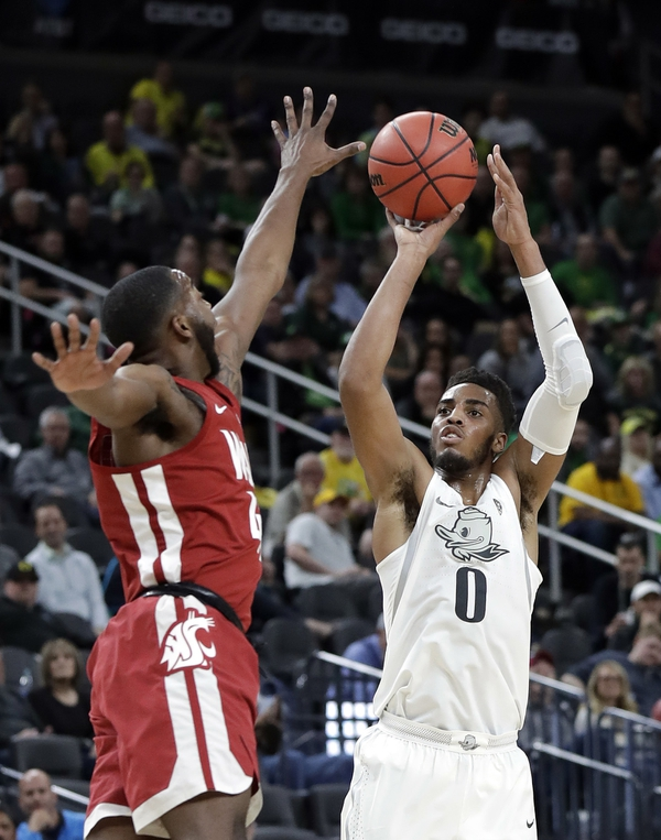 Oregon's Troy Brown, right, shoots over Washington State's Kwinton Hinson during the first half of an NCAA college basketball game in the first round of the Pac-12 men's tournament Wednesday, March 7, 2018, in Las Vegas. (AP Photo/Isaac Brekken)