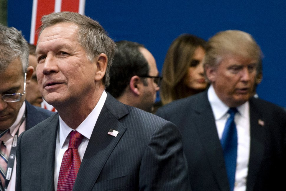 FILE - In this Feb. 6, 2016, file photo, Ohio Gov. John Kasich, left, and Donald Trump, right, speak to reporters after a Republican presidential primary debate in Manchester, N.H. Kasich is skipping a Republican Party fundraiser Friday, Aug. 24, 2018, where Trump is the headliner. Kasich's decision comes as no surprise. The two are locked in a fierce and public rivalry. (AP Photo/Matt Rourke, File)
