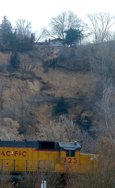 (Al Hartmann | The Salt Lake Tribune) Unstable slope beneath house near 4860 S. 600 W. in Riverdale Wednesday Nov. 29. Four houses in a row whose backyard's facing west, with railroad tracks and the Weber River Parkway below have been evacuated due to a landslide.