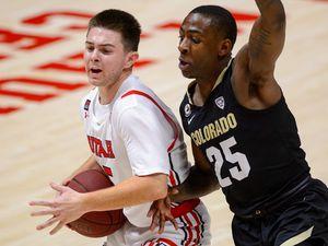 (Trent Nelson  |  The Salt Lake Tribune) Utah Utes guard Rylan Jones (15) defended by Colorado Buffaloes guard McKinley Wright IV (25) as Utah hosts Colorado, NCAA basketball in Salt Lake City on Monday, Jan. 11, 2021.