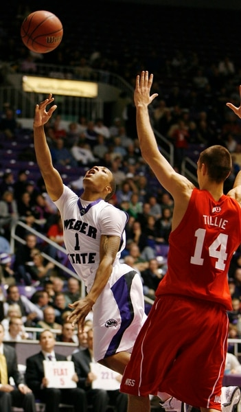 (Steve Griffin | Tribune file photo) In 2009, Weber State's Damian Lillard scopes in two over Utah's Kim Tillie, who led the Utes with 20 points. But Lillard scored 28 as Weber State sent Utah back to Salt Lake City with an 83-76 loss.