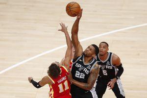 San Antonio Spurs forward Rudy Gay (22) battles Atlanta Hawks guard Trae Young (11) for a jump ball during the first half of an NBA basketball game on Friday, Feb. 12, 2021, in Atlanta. (AP Photo/Todd Kirkland)